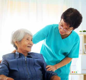lady caregiver talking with her patient