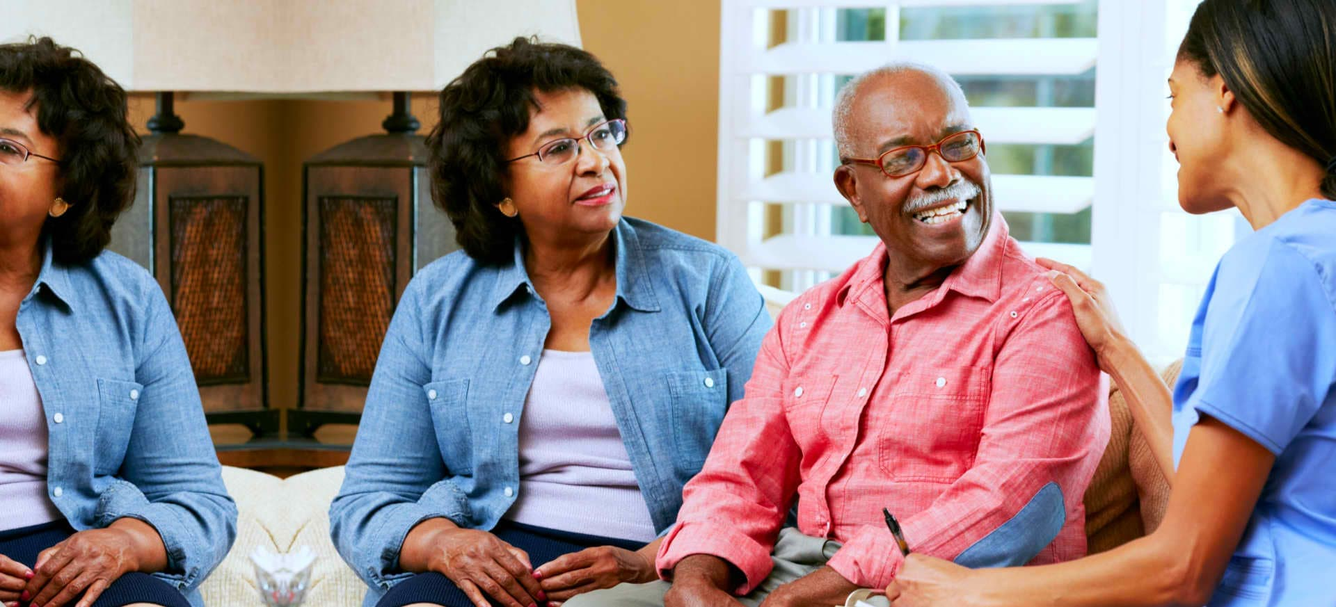 old couple talking to their caregiver