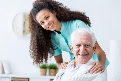 senior man and caregiver